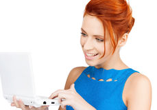 Smiling woman with laptop computer Royalty Free Stock Images