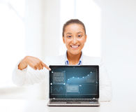Smiling woman with laptop computer Stock Images