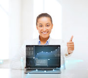 Smiling woman with laptop computer Royalty Free Stock Image