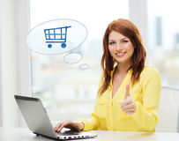 Smiling woman with laptop computer shopping online Stock Photos