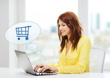 Smiling woman with laptop computer shopping online Royalty Free Stock Photo