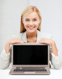 Smiling woman with laptop pc Stock Photography