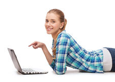 Smiling woman with laptop and pointing finger Royalty Free Stock Photography