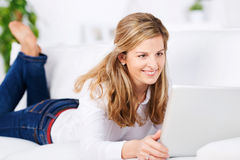 Smiling Woman With Laptop On Sofa Royalty Free Stock Photography