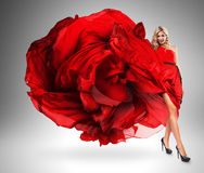 Smiling woman in large red dress Royalty Free Stock Photos