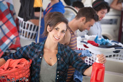 Smiling Woman In Laundromat Royalty Free Stock Photos