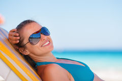 Smiling woman laying on beach Royalty Free Stock Photos