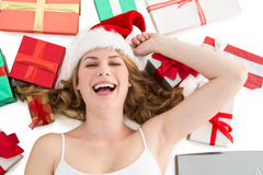 Smiling woman laying on the floor with gifts around her Stock Images