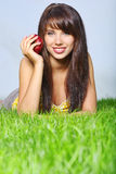 Smiling woman laying on grass Royalty Free Stock Image
