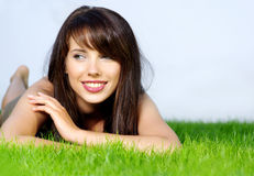 Smiling woman laying on grass Royalty Free Stock Photography
