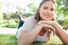 Smiling woman laying on the lawn Royalty Free Stock Images