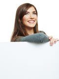 Smiling woman leaning on big blank board . Close up female face Royalty Free Stock Images