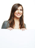 Smiling woman leaning on big blank board . Close up female face Royalty Free Stock Photos