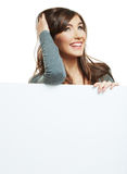 Smiling woman leaning on big blank board . Close u Royalty Free Stock Image