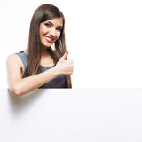 Smiling woman leaning on big blank board . Stock Photography