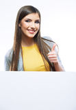 Smiling woman leaning on big blank board . Stock Photo