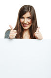 Smiling woman leaning on big blank board . Royalty Free Stock Photo