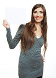 Smiling woman leaning on big blank board . Royalty Free Stock Photos