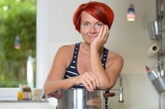 Smiling Woman Leaning her Arms on Cooking Pot Royalty Free Stock Images
