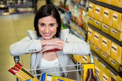 Smiling woman leaning on troller Royalty Free Stock Images