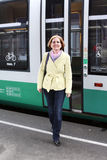 The smiling woman leaves the train Stock Photo