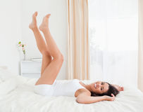 Smiling woman legs raised up high Royalty Free Stock Photography
