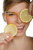 Smiling woman with lemon Royalty Free Stock Image