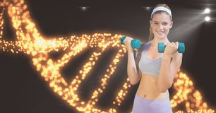 Smiling woman lifting dumbbells against DNA structure. Digital composite of Smiling woman lifting dumbbells against DNA structure Royalty Free Stock Photo
