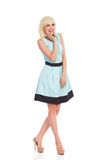 Smiling woman in light blue color dress Royalty Free Stock Images