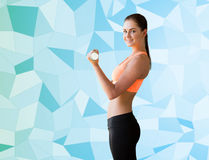 Smiling woman with light dumbbell flexing biceps Royalty Free Stock Photo