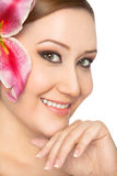 Smiling woman lily in hair Stock Photography