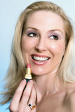 Smiling woman with lipstick Stock Photo