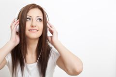 Smiling woman listen to the music Royalty Free Stock Photos