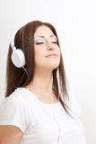 Smiling woman listen to the music Stock Photography