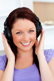 Smiling woman listen to music with headphones Royalty Free Stock Images