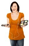 Smiling woman listening media player Stock Photos