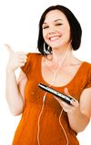 Smiling Woman Listening Media Player Stock Photo