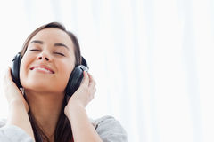 A smiling woman listening to her headphones Royalty Free Stock Images