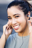 Smiling woman listening to music Stock Image