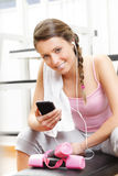 Smiling woman listening to music at the gym Royalty Free Stock Photos