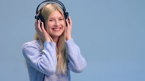 Smiling woman listening to music in headphones stock video