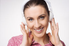 Smiling woman listening to music Stock Photos