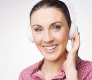 Smiling woman listening to music Stock Images
