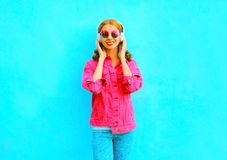 smiling woman listens to music in wireless headphones Royalty Free Stock Photos