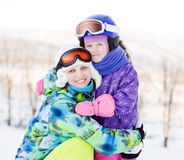 Smiling woman and little girl at the ski resort Royalty Free Stock Photo
