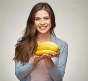 Smiling woman with long hair holding banana. Vitamin healthy food Royalty Free Stock Photos