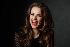 Smiling woman with long wavy brown hair and red lips Royalty Free Stock Photos