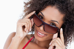 Smiling woman looking aver her sunglasses Royalty Free Stock Image