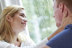 Smiling woman looking at boyfriend with love and tender. Pretty young mixed-race women looking at boyfriend with love and tender when taking to him stock photo