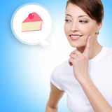 Smiling  woman looking on cake Royalty Free Stock Images